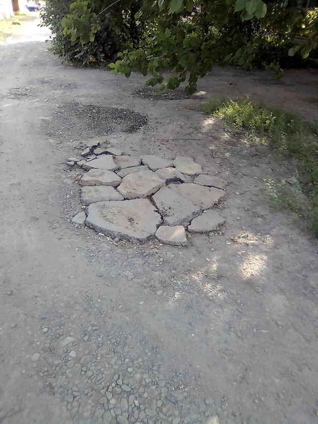 Ремонт ям на проезжей части автодорог в Таганроге